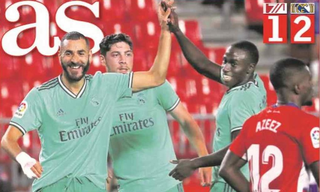 Front page of sports newspapers: Real Madrid with hand in the cup